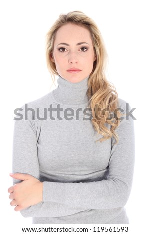 Fashion model in turtle neck shirt shows serious face. - stock photo