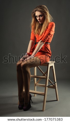 Fashion model. Posing in studio. - stock photo