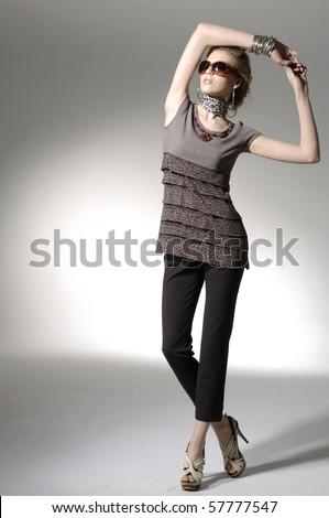 fashion model posing on light background - stock photo