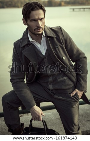 Fashion model posing outdoor - stock photo