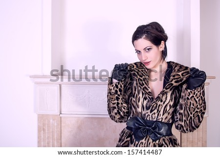 fashion model wearing fur and leather - stock photo