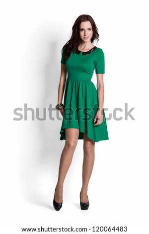 Fashion model wearing green dress with emotions - stock photo