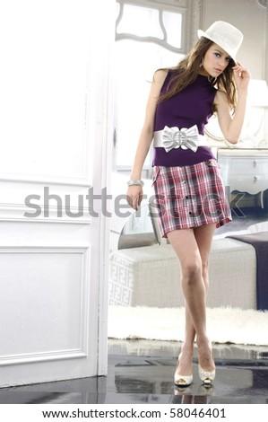 fashion model wearing hat posing in the studio - stock photo