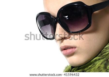 Fashion model wearing the big modern sunglasses. - stock photo