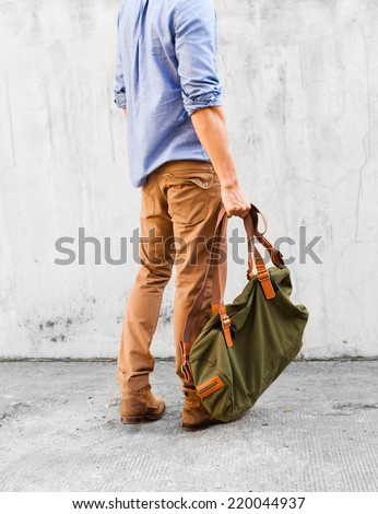 Fashion model with bag - stock photo