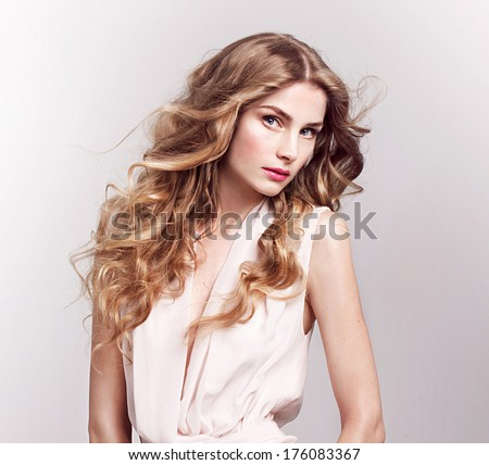 Fashion model with blonde curly hair , spring look, - stock photo