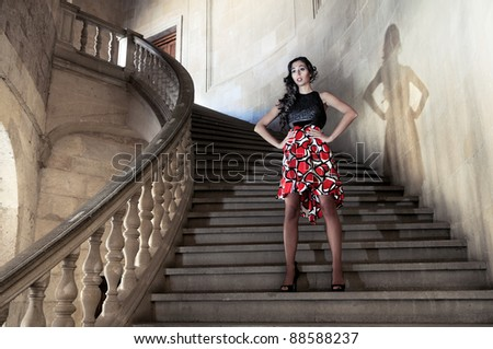 Fashion model with designer dress at the Charles V Palace in Alhambra, Granada, Spain - stock photo