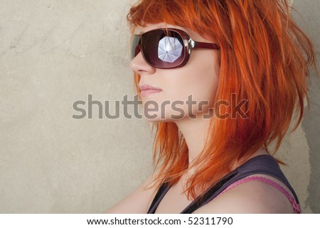 Fashion model with red hair posing on a vintage background - stock photo