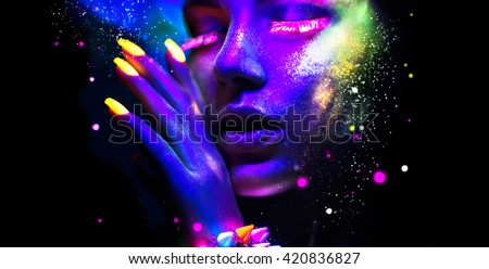 Fashion model woman in neon light, portrait of beautiful model with fluorescent make-up, Art design of female disco dancers posing in UV, colorful make up. Isolated on black background - stock photo