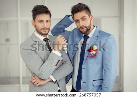 Fashion models posing in jacket - stock photo