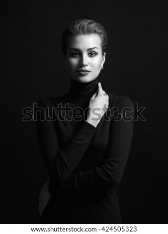fashion monochrome beauty portrait of young woman in a black roll neck jumper. beautiful girl with short hair - stock photo