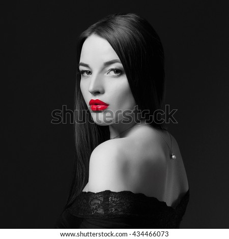 fashion monochrome photo of glamor beautiful young woman with red lips.beauty brunette girl - stock photo