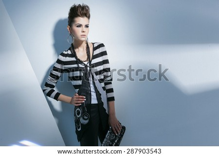 fashion or casual woman portrait holding purse posing - stock photo