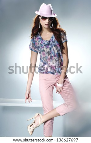 fashion or casual woman portrait wearing sunglasses in hat posing studio - stock photo