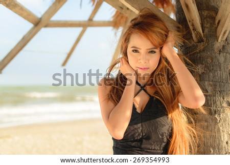 Fashion outdoor photo of beautiful woman with bikini relaxing on summer beach - stock photo