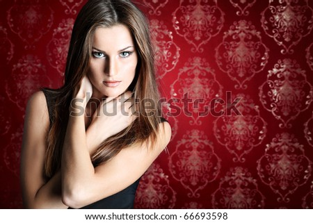 Fashion photo, a model is posing over vintage  background - stock photo