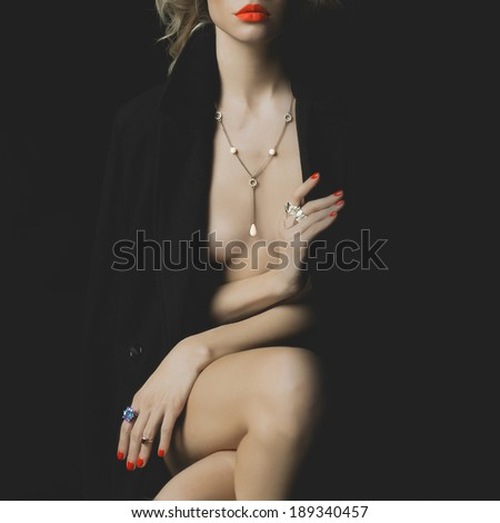 Fashion photo of a nude beauty with bright makeup and jewelry - stock photo