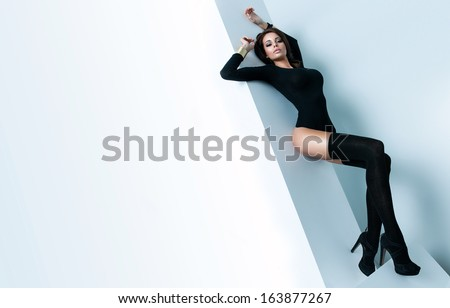 Fashion photo of a sexy woman with space  - stock photo