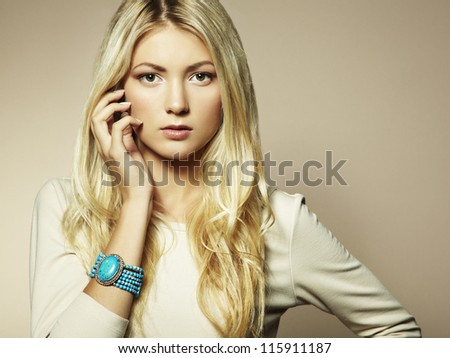 Fashion photo of a young woman with blond hair. Close-up - stock photo