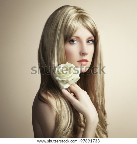 Fashion photo of a young woman with blond hair. Close-up portrait - stock photo