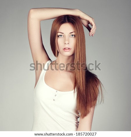 Fashion photo of a young woman with red hair. Close-up portrait - stock photo