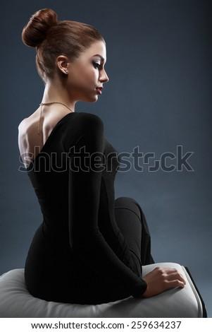 Fashion photo of beautiful lady in elegant black evening dress - stock photo