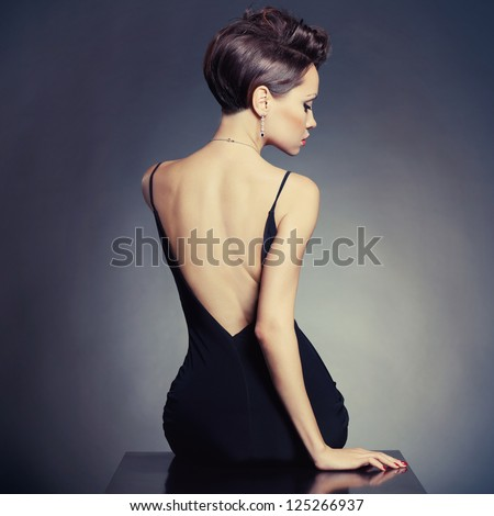 Fashion photo of beautiful lady in elegant evening dress - stock photo