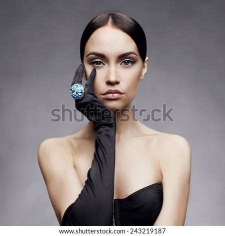 Fashion photo of beautiful lady in gloves with diamond ring - stock photo
