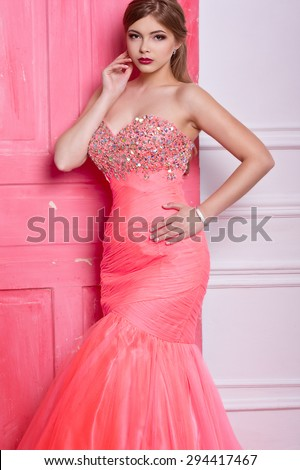 Fashion photo of beautiful sensual woman with long dark hair in luxurious sequin dress - stock photo