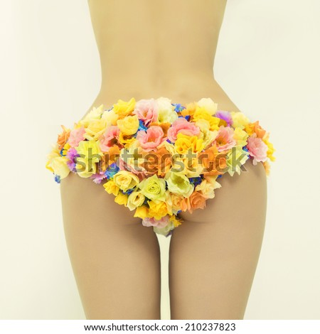 Fashion photo of beautiful slender lady in floral bikini - stock photo