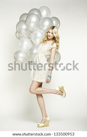 Fashion photo of beautiful woman with balloons. Girl posing. Studio photo - stock photo