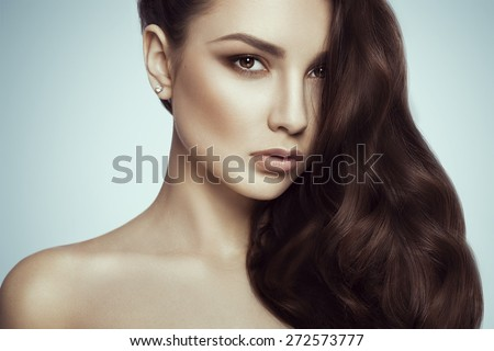 Fashion photo of brunette beauty with natural make-up, perfect skin and  body. Concept of freshness and purity girls. - stock photo