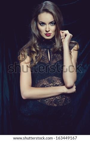 fashion photo of sexy brunette woman wearing lace top - stock photo
