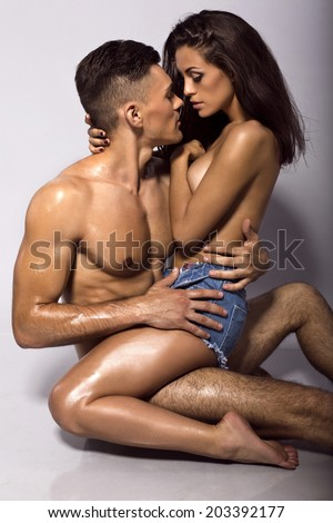fashion photo of sexy impassioned couple with tanned bodies - stock photo