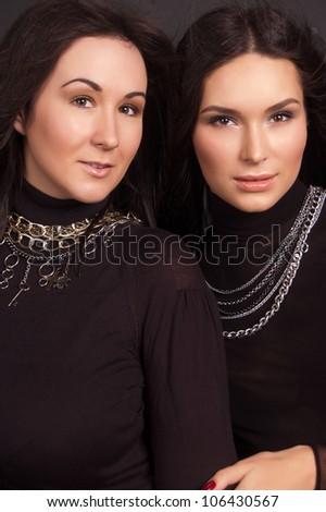 Fashion photo of two young women - stock photo