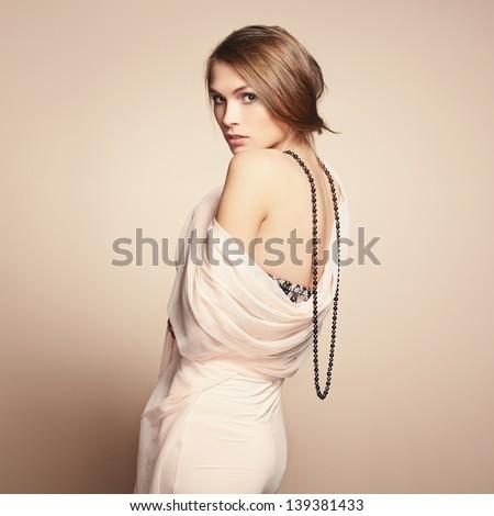 Fashion photo of young beautiful woman. Girl posing. Studio photo - stock photo