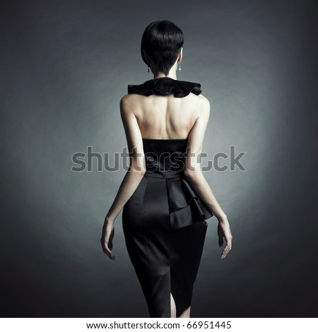 Fashion photo of young lady in elegant evening dress - stock photo