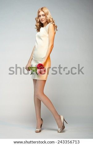 Fashion photo of young magnificent woman. Girl posing. Studio photo. The female figure - stock photo