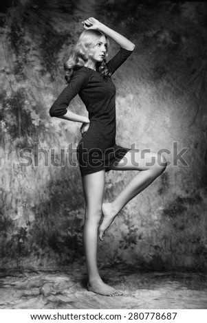 Fashion photo of young magnificent woman. Girl posing. Studio photo. The female figure. Black dress - stock photo