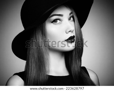 Fashion photo of young magnificent woman in hat. Girl posing. Studio photo.  Perfect Makeup. Black and white - stock photo
