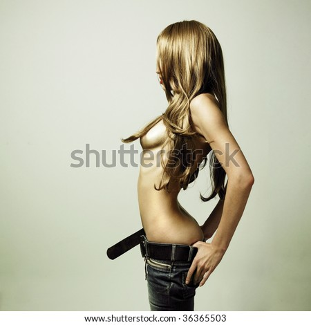 Fashion photo of young sensual woman in jeans - stock photo