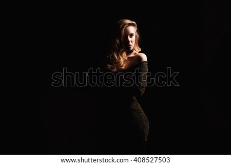 Fashion photo of young woman in elegant evening dress - stock photo