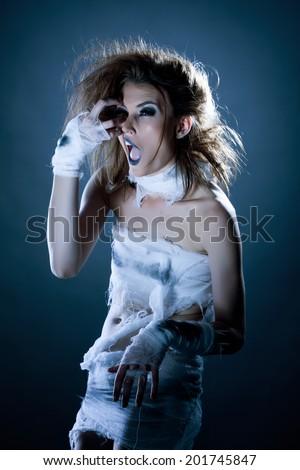 Fashion photography - pretty model posing as mummy - stock photo