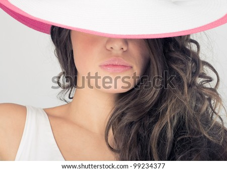 Fashion photos delightful woman in a white hat, close-up. - stock photo