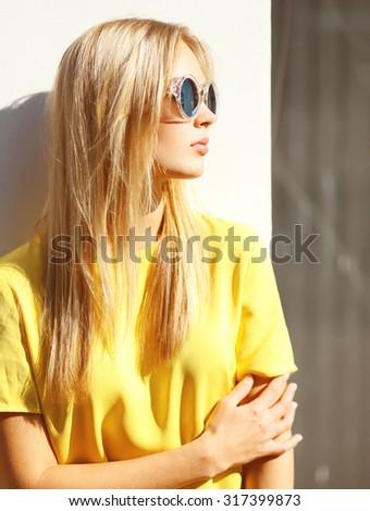 Fashion portrait closeup profile pretty young blonde in sunglasses outdoors - stock photo