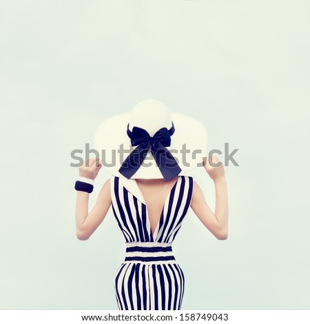 Fashion portrait of a beautiful girl on vacation - stock photo