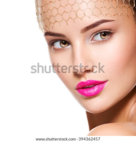Fashion portrait of a beautiful  girl wears veil on forehead. bright make-up. Isolated on white background - stock photo