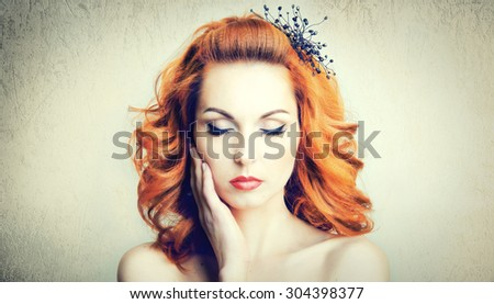 Fashion portrait of a beautiful young girl model with designer decorations - stock photo
