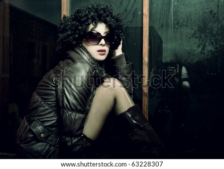 Fashion portrait of a beautiful young sexy woman wearing sunglasses. Art disco style - stock photo