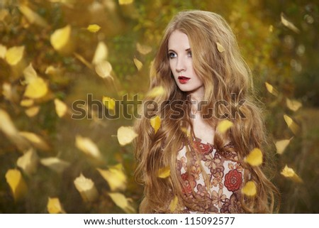 Fashion portrait of a beautiful young woman in autumn forest. Beauty autumn - stock photo